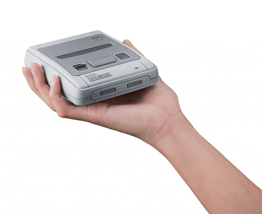 Image of a hand holding a cheap snes mini